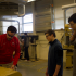 "Mike Brown demonstrates how to use a planer in the woodshop for James Strevey, sophomore, and Henri Friedeck, junior. ""He's a good teacher who is really interactive,"" Friedeck said."