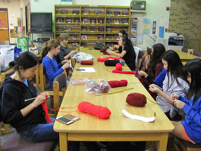 Kids knitting it forward