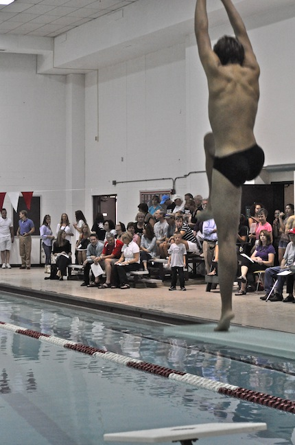 Alex Guess, junior, takes a practice dive before the meet.