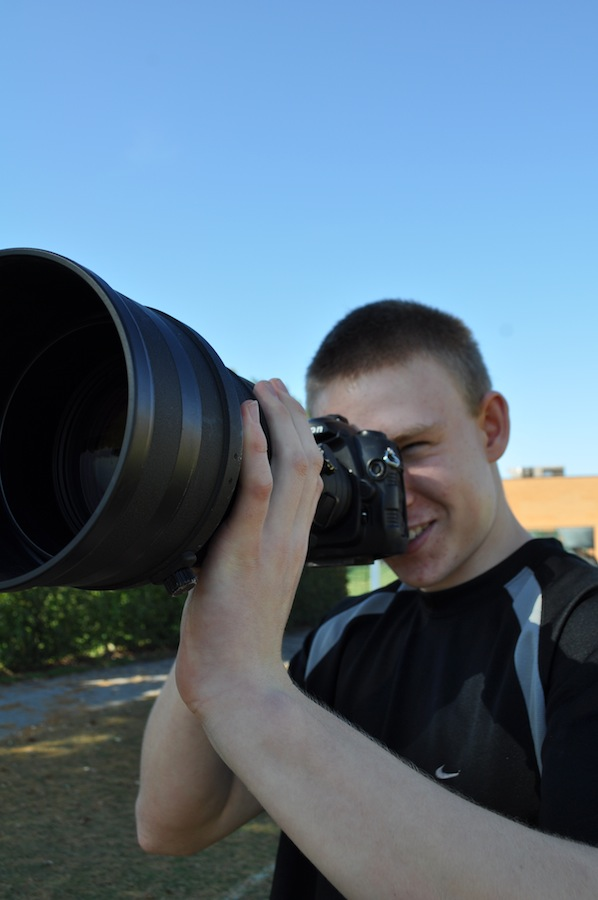 Trevor Currie, freshman, is here with his camera. He is a winner of multiple photography contests.
