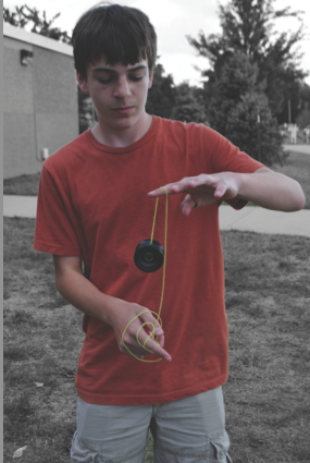 Josh Demetri, freshman, demonstrates some of his technique using one of his plastic yo-yos  Sept 23, 2013.
