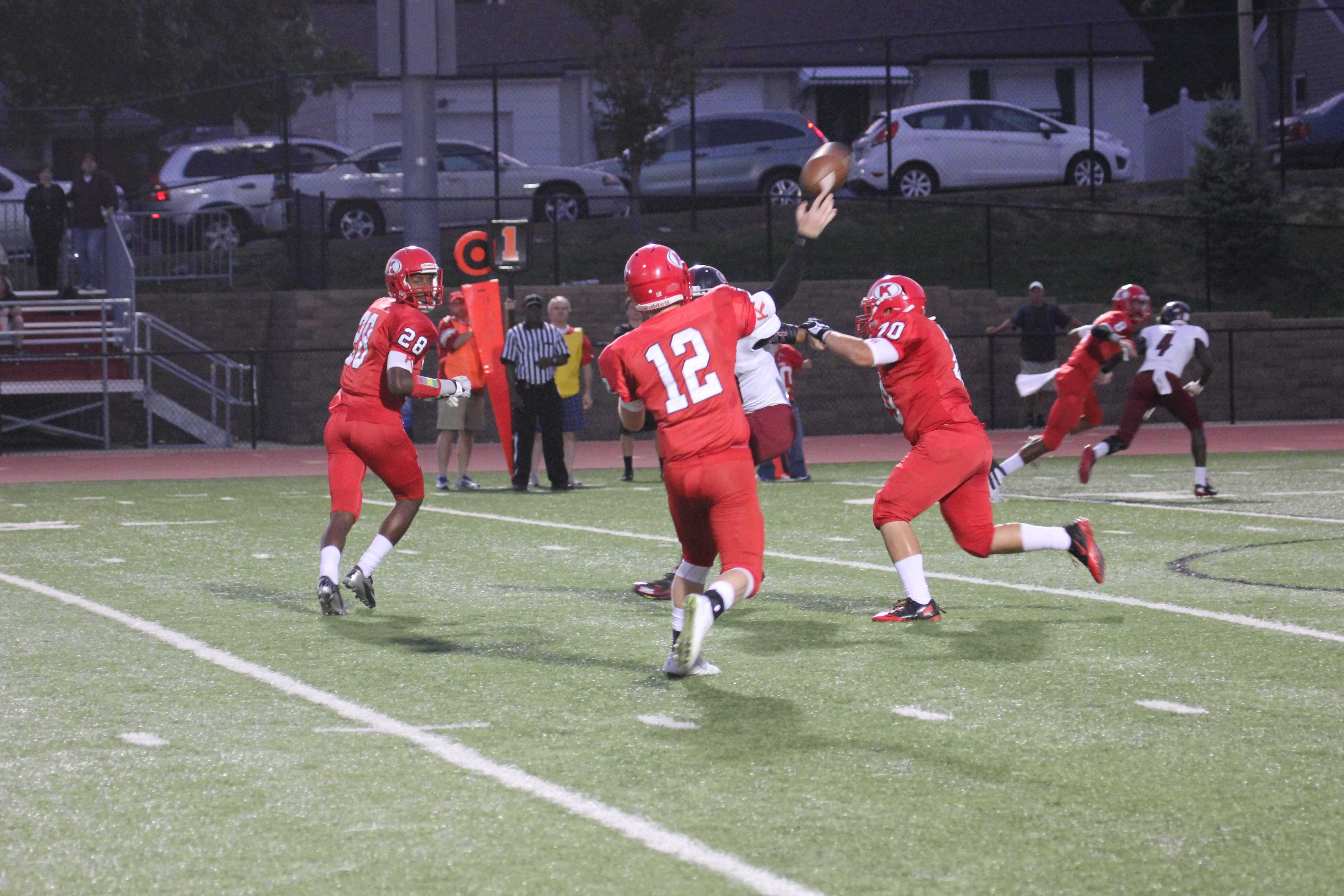 Wil Hadler, senior quarterback, takes a shot at the end zone during Kirkwood's 52-28 victory against Rockwood Summit.