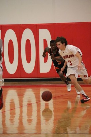 Sam Gunn, sophomore, takes the ball down the court.