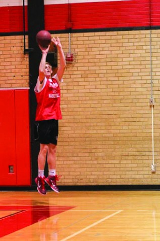 Sam Goretzke, senior, shoots from beyond the arc at practice.