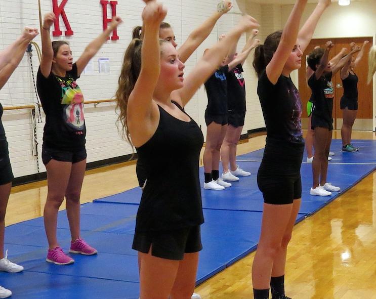 Cheerleaders rehearsing chants at practice Aug. 3