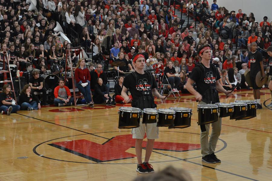 Senior David Reynolds and Junior Benjamin Comfort perform with the drum line during the pep rally.