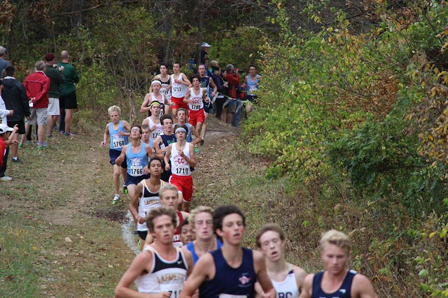 Boys%27+cross+country+makes+their+way+through+the+pack+to+reach+the+front.+The+top+seven+runners+are+chosen+to+run+for+Kirkwood+in+the+race.