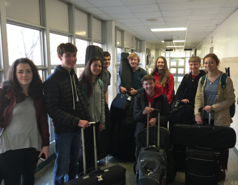 KHS all-state orchestra students smile before their departure to the Lake of the Ozarks for Missouri Music Educators Association conference. From left to right: Kate Miller, Charlie Hamilton, Claire Lin, Pieter Boswinkel, Clayton Pokorny, Merrick Schnider, David Decker, Bella Boshara.