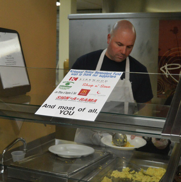 Former KHS school resource officer Chad Walton serves eggs at last year's Police Benevolent Fund Pancake Supper.