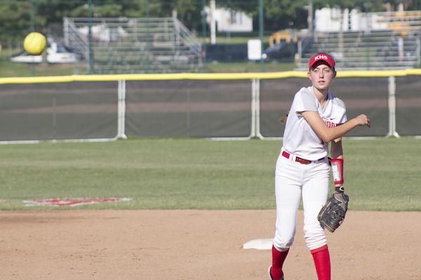 Lauren Hammett, junior, throws a ball to her teammate at first base.