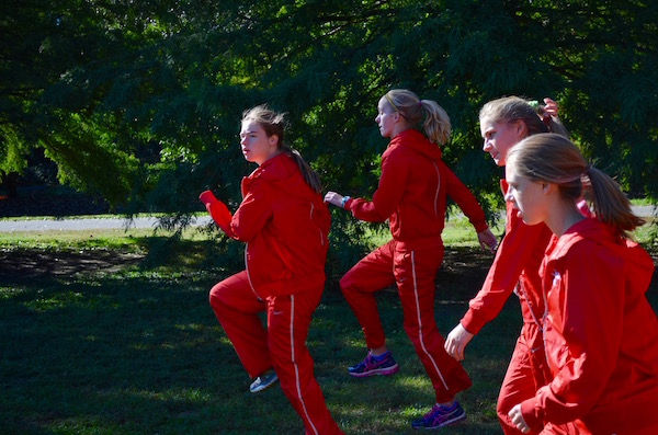Grace+Murphy%2C+junior%2C+focuses+on+her+warm-up+drills+before+running+the+JV+-+Gold.%0A