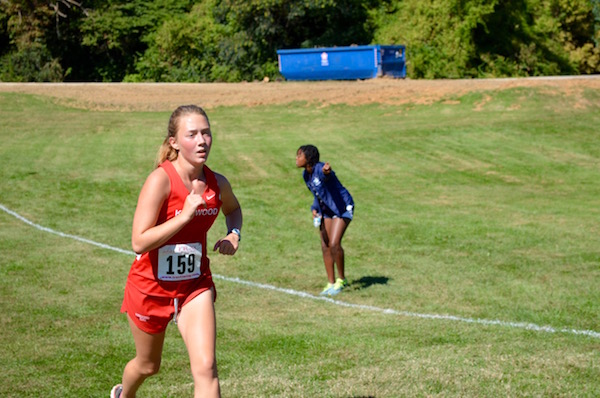 Julia+Smotkin%2C+freshman%2C+starts+to+pick+up+speed+as+she+nears+the+finish+and+places+49th+in+the+freshman+race.
