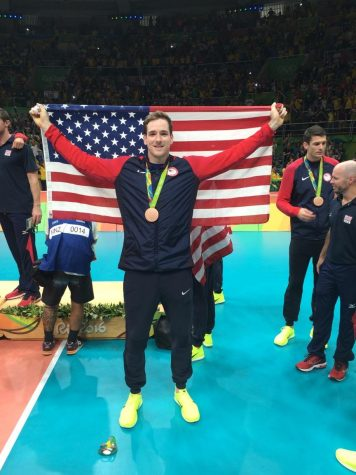 Troy holding up an American flag after winning the bronze medal in Rio.