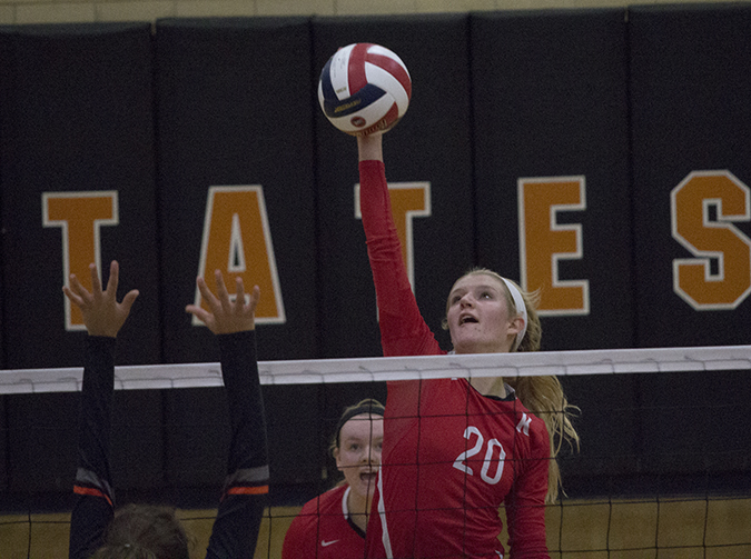 Kara Steele, senior, sets the ball to the Webster girls varsity volleyball team.