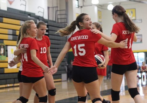 Jenna Schoch, freshman, looks back at the scoreboard as she and her teammates celebrate scoring a point.