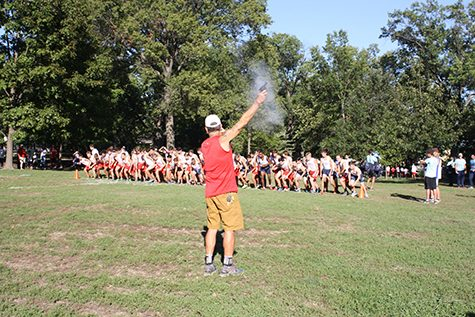 Wayne Baldwin, boys' cross country coach, sets off the gun for the JV Blo Pop race.