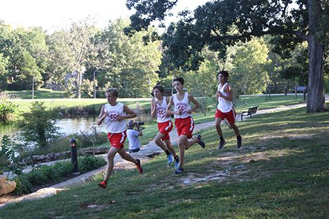 Finn Sinner and Kenan Dogan, sophomores, Bela Cseri, junior, and Jack Harre, senior, run on their third lap of the race.