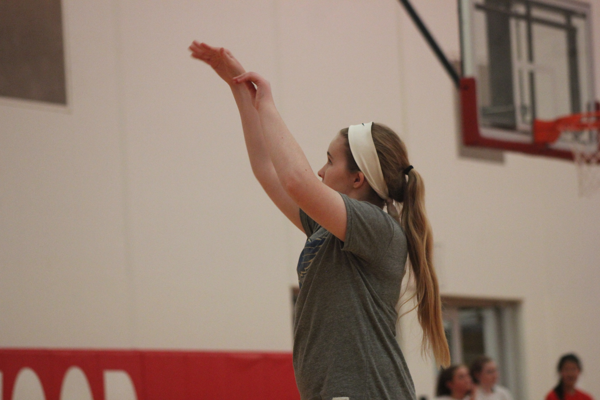 Emily+Hovey%2C+sophomore%2C+aims+and+shoots+the+ball+during+JV+girls+basketball+practice.+%22%5BI+am%5D+very+excited+for+this+upcoming+basketball+season%2C%22+Hovey+said.+%22I%27m+looking+forward+to+doing+everything+I+can+to+become+a+better+player.%22