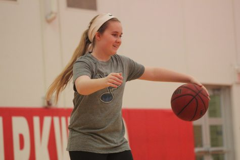 Emily Hovey, sophomore, warms up during JV girls basketball practice.