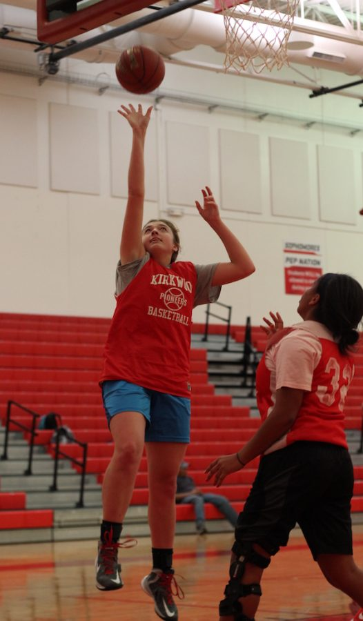 Ashley+Anderson%2C+junior%2C+does+a+layup+during+a+conditioning+drill.