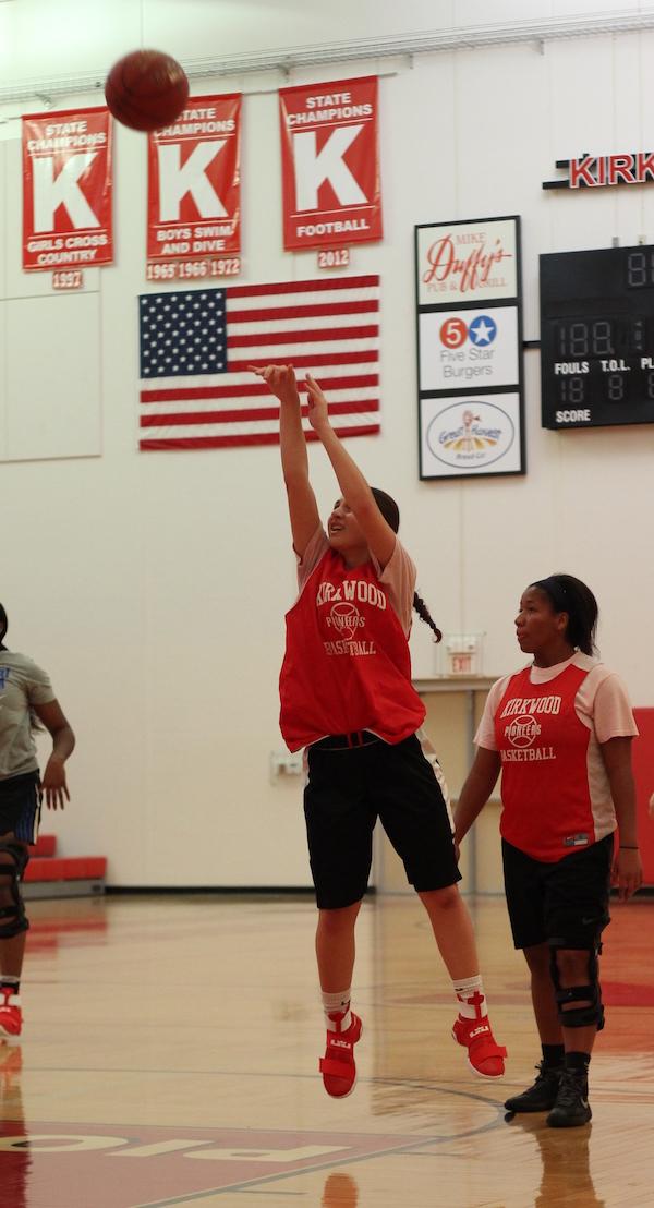 Gabby+Sousou%2C+senior%2C+shoots+a+basket+from+half+court.