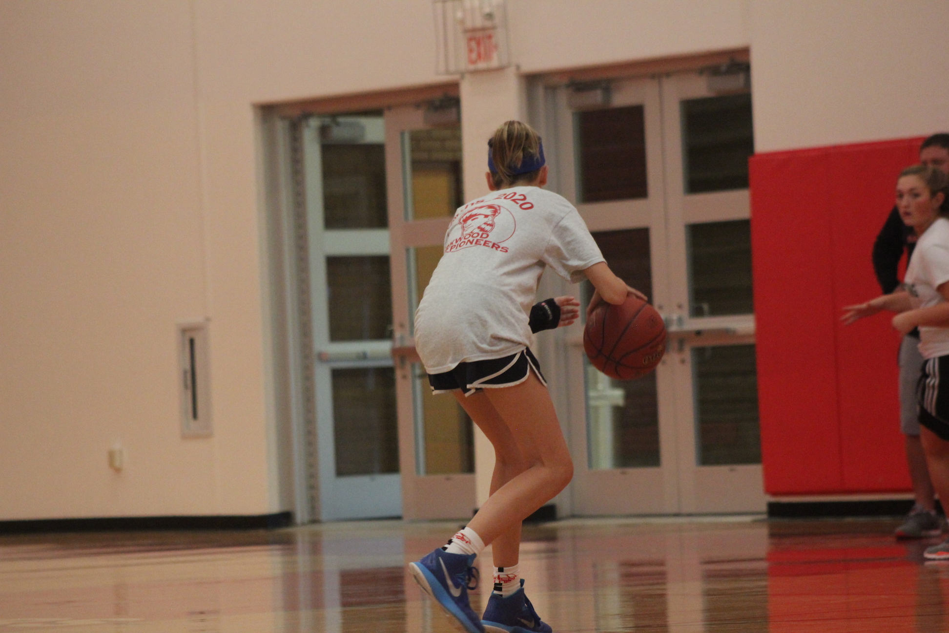 Riley+Mulvaney%2C+freshman%2C+dribbles+before+a+pass+during+JV+girls+basketball+practice.