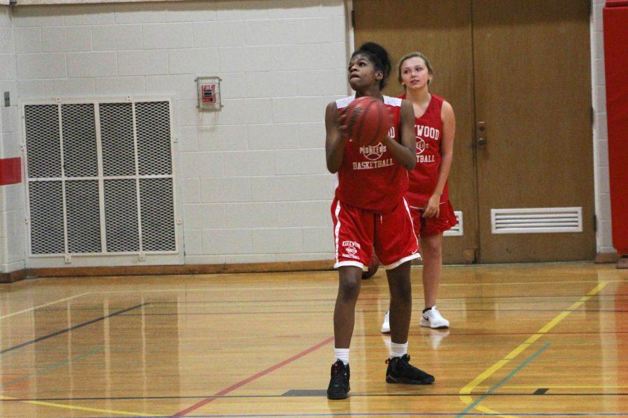 Daneen Burks, freshman, prepares to shoot the basketball.