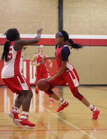 Jayla Everett, junior, tries to push past her teammate and get to the basket.