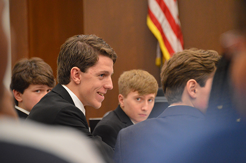 Tim Knight, defense lawyer and junior, talks with members of the KHS mock trial team.