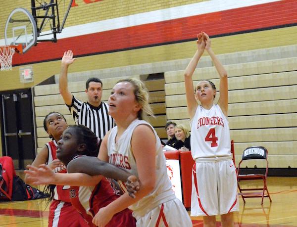 Rylee+Mulvaney%2C+freshman%2C+shoots+a+three-pointer+while+Natalie+Sweesy%2C+freshman%2C+pushes+towards+the+basket.