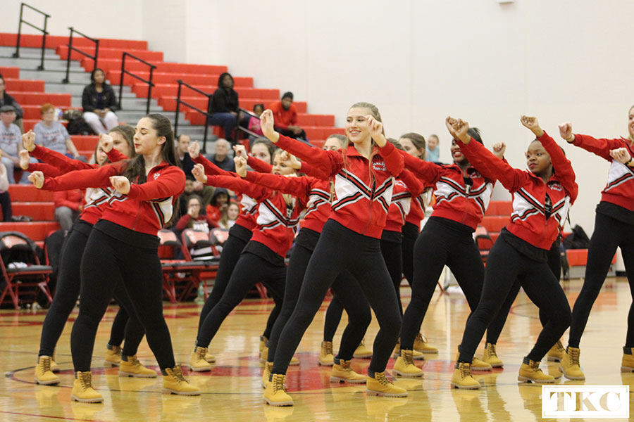 Melanie Witt, junior, performs their halftime routine with the KHS varsity Pommies.