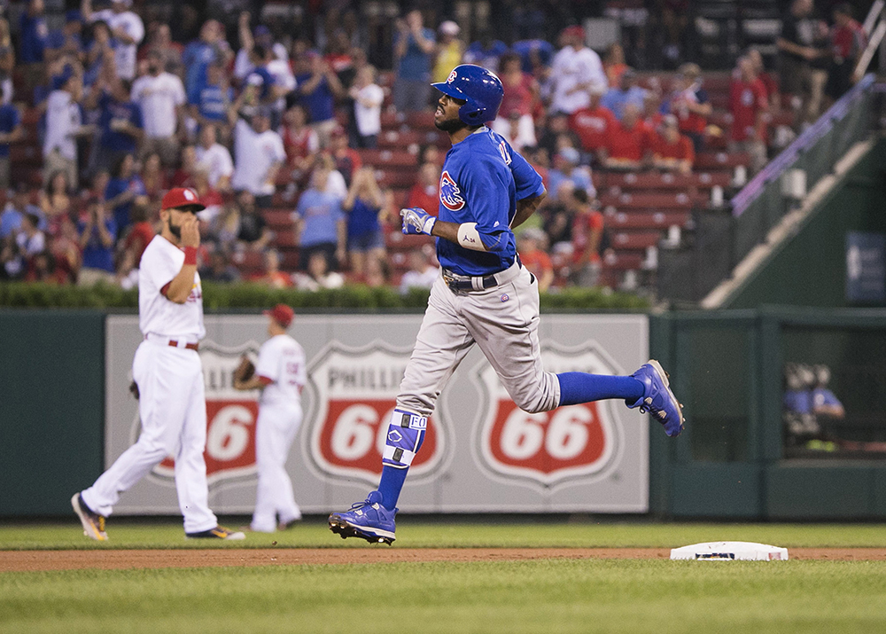 Fowler rounds the bases after he hits a home run against the Cardinals at Busch Stadium Sept. 13, 2016.