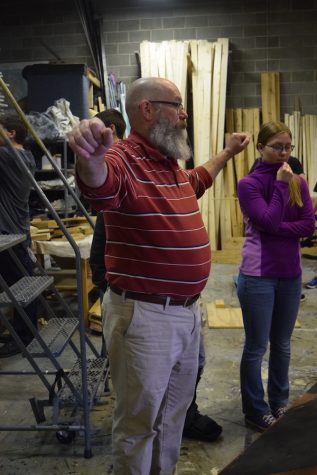 Gregory Booth, tech director, gives building instructions to crew members.