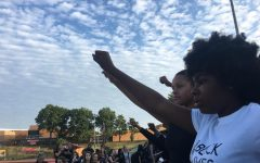 Sha'diya Tomlin, leader of the walkout, raises her fist in the air. The walkout is in response to the Jason Stockley verdict that rocked the St. Louis area on Friday.