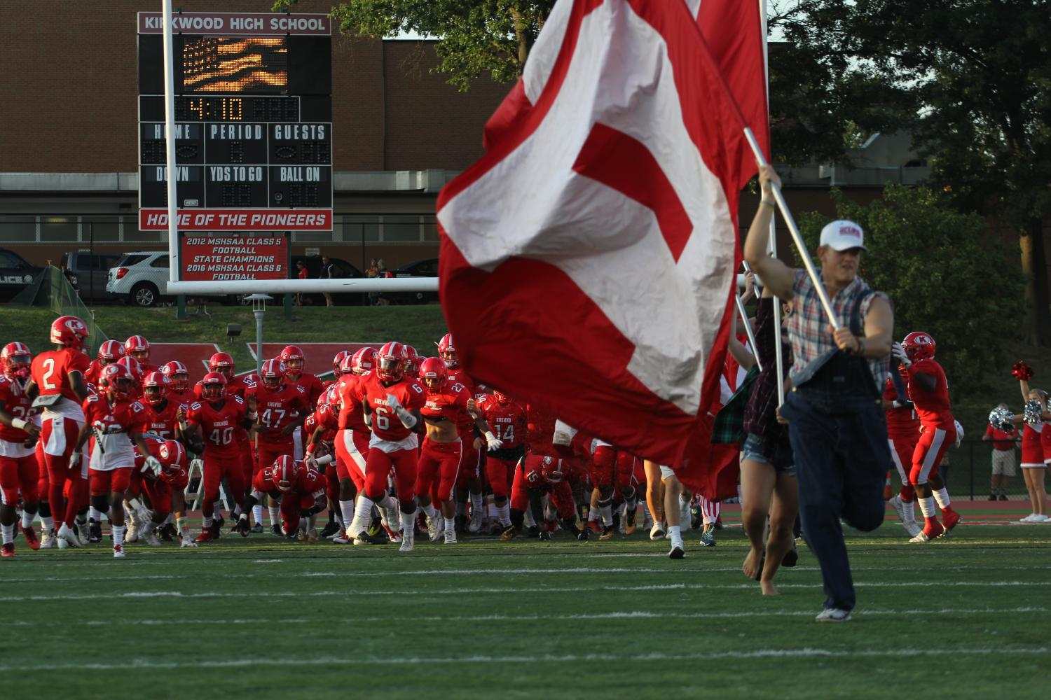 KHS+Pep+Nation+and+varsity+football+players+make+their+entrance+onto+the+field%2C+ready+to+start+their+first+home+game+on+Aug.+25th.%0A