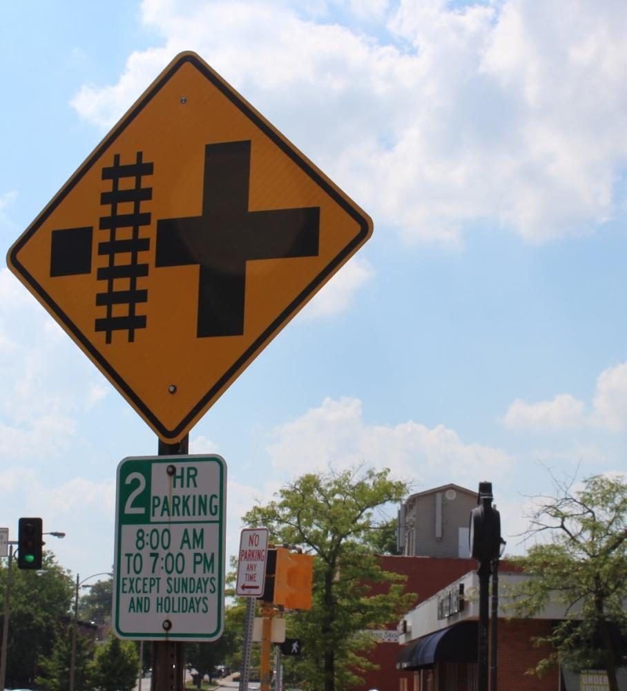 Picture of a railroad crossing sign in downtown Kirkwood.
