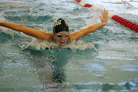 Allie Hickenbotham, senior, swims butterfly.