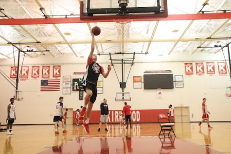 Jonah McDowell, junior, performs layup.
