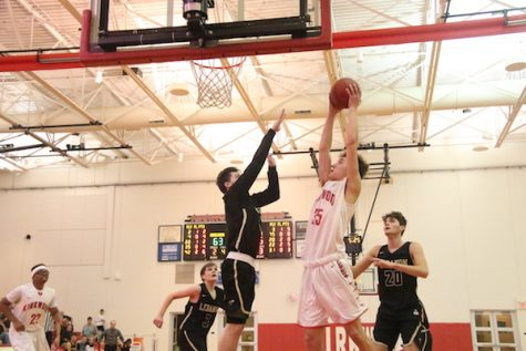Jack Martell, sophomore, goes up for a layup over Lebanon defense.