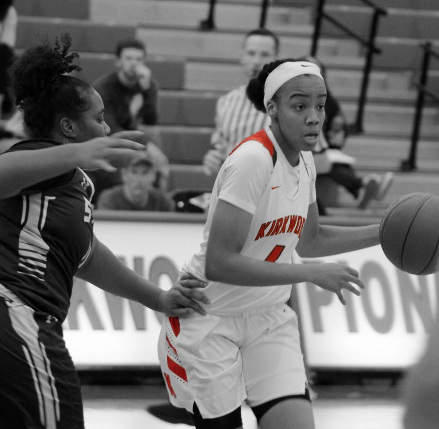 Jayla+Everett%2C+senior%2C+defends+the+ball+from+a+McCluer+North+player.