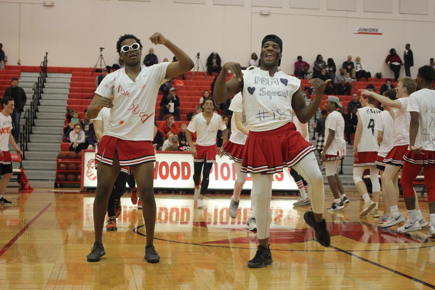 TJ+Phipps+and+Tyriek+Lewis%2C+seniors%2C+perform+their+dance+routine+with+the+Male+Poms.+