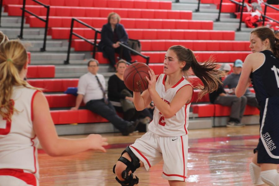 Kate Jozwiakowski, sophomore, prepares to shoot a basket.