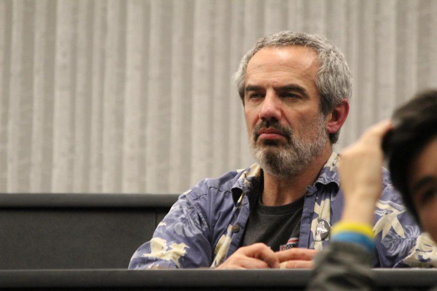 Bob Becker, chemistry teacher, listens to Dana Veasman talk about sexual assault.