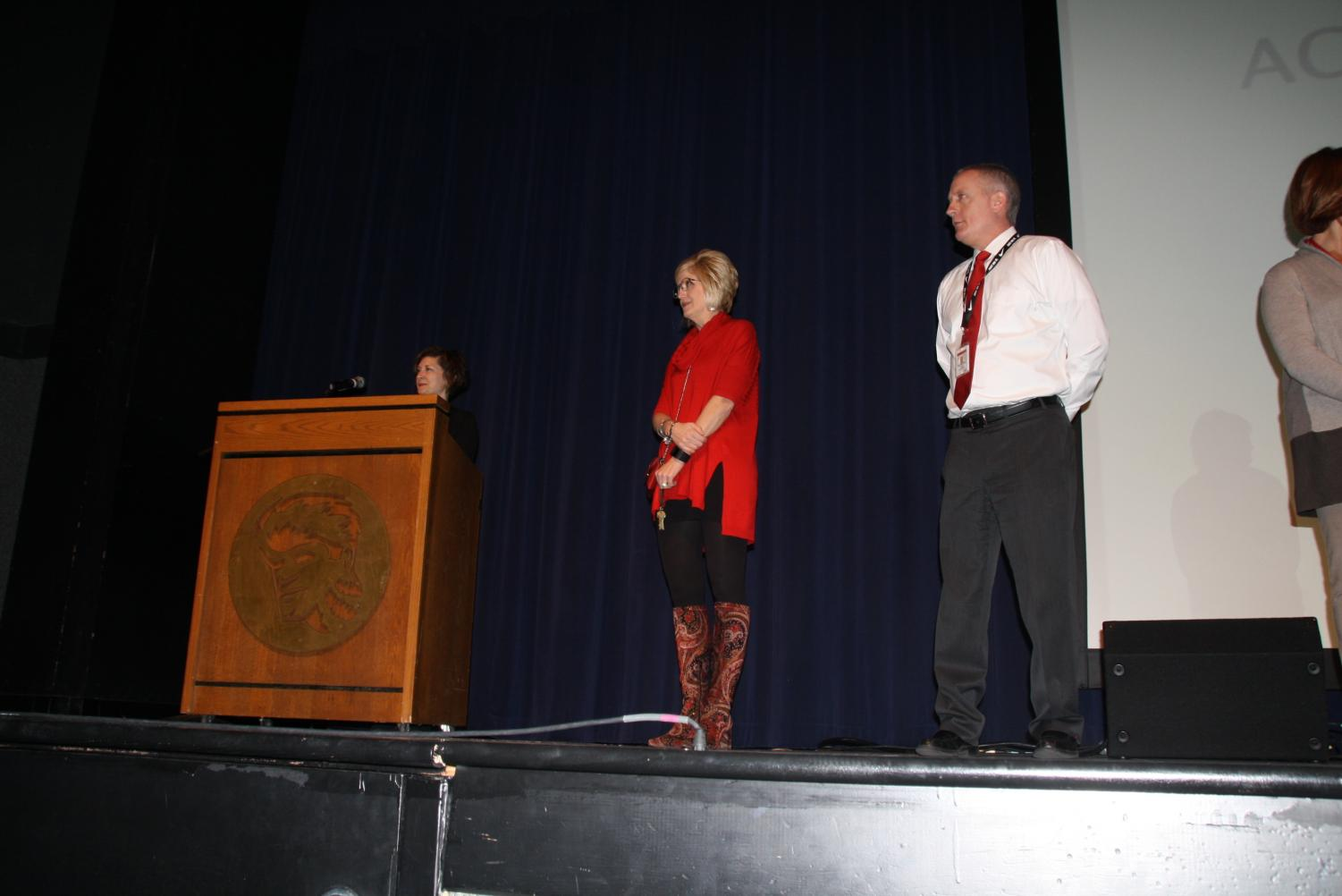 Dr.+Mike+Havener%2C+principal+and+Dr.+Jessica+Vehlewald%2C+assistant+principal%2C+stand+on+stage+to+give+students+awards.