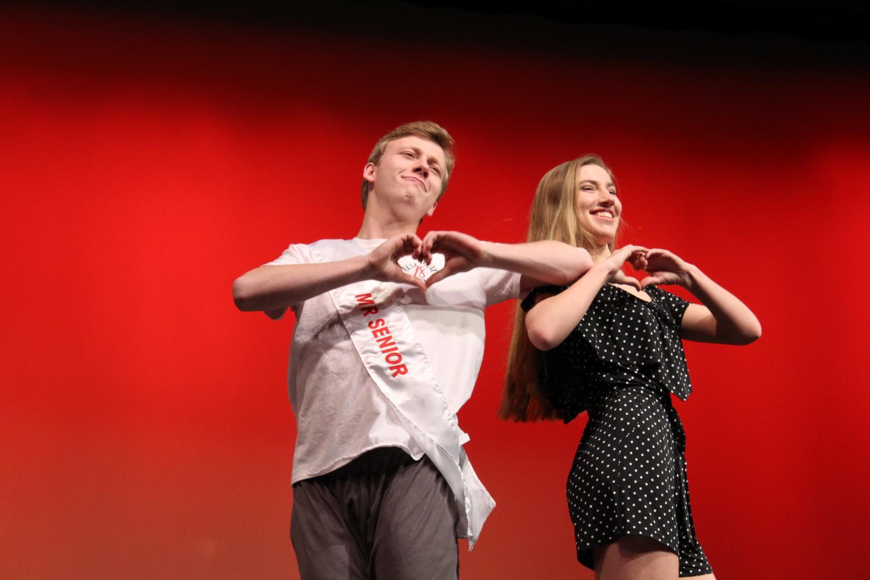 Clayton+Pokorny+and+Melanie+Witt%2C+seniors%2C+make+hearts+for+their+audience.
