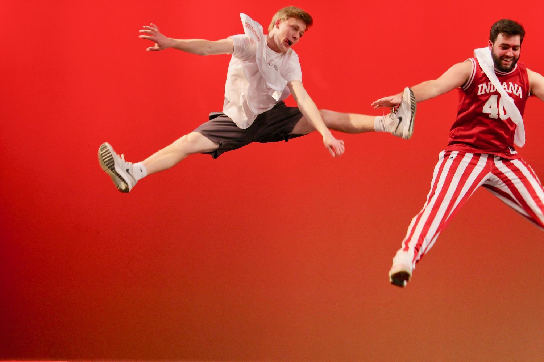 Clayton+Pokorny%2C+senior%2C+does+a+straddle+jump+in+their+dance+routine.+