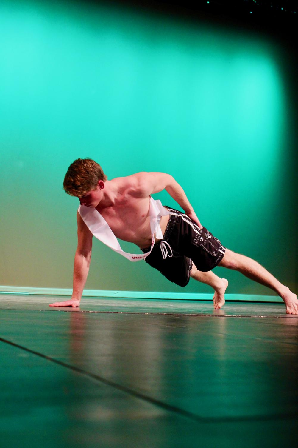 Jack+Krus%2C+senior%2C+wows+the+crowd+with+a+one-handed+push-up+during+the+swimwear+segment.+%22I%27ve+been+trying+to+do+as+much+as+I+can+senior+year%2C+so+I+did+Male+Poms+and+had+a+lot+of+fun+with+that+and+%5BMr.+KHS%5D%2C%22+Jack+Krus%2C+senior%2C+said.+%22A+lot+of+my+friends+were+doing+it+so+I+tried+out+to+see+if+it+would+be+fun+and+it+was.%22