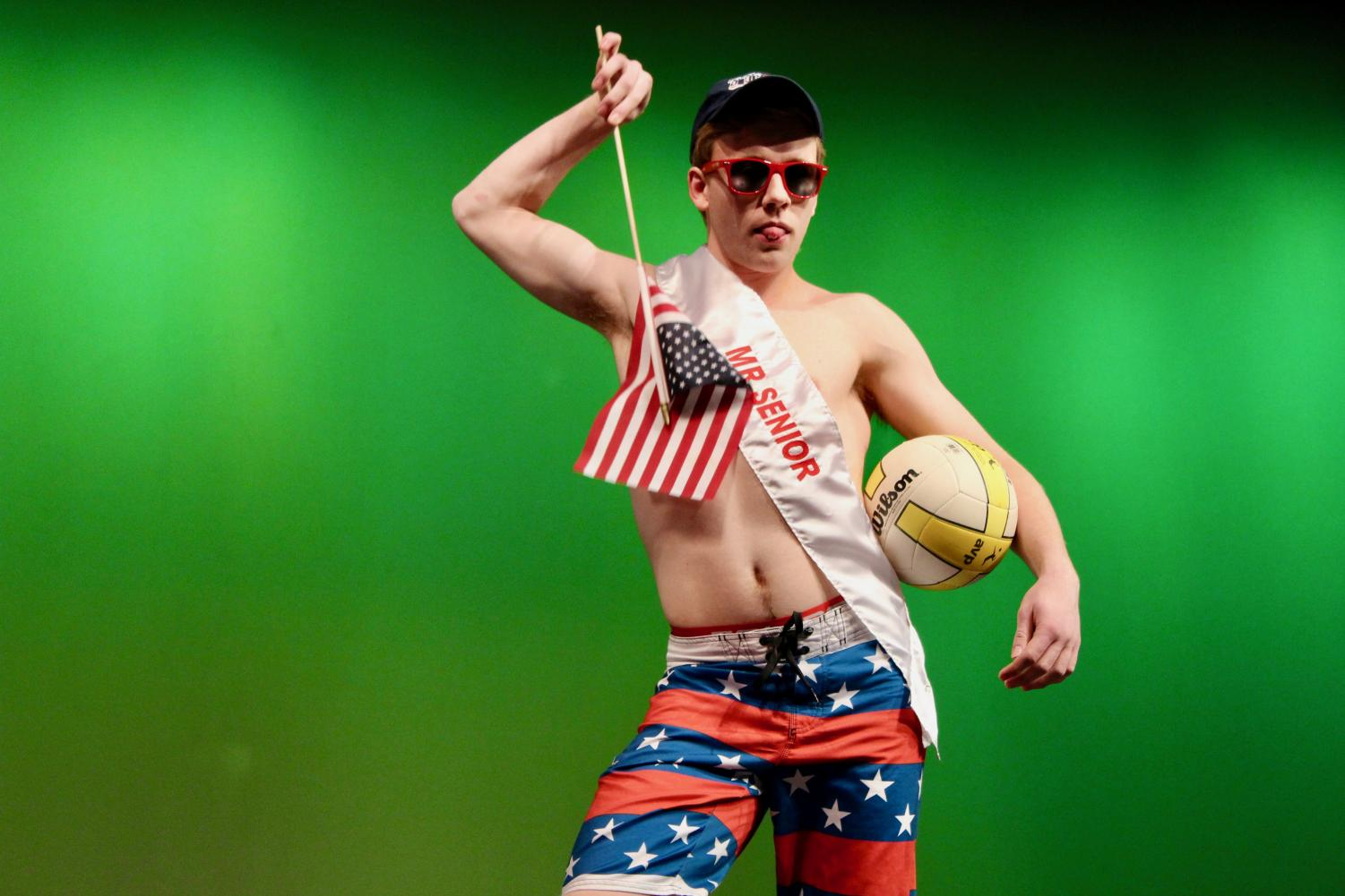 Clayton+Pokorny%2C+senior%2C+poses+with+an+American+flag+during+the+swimsuit+segment+of+the+contest.