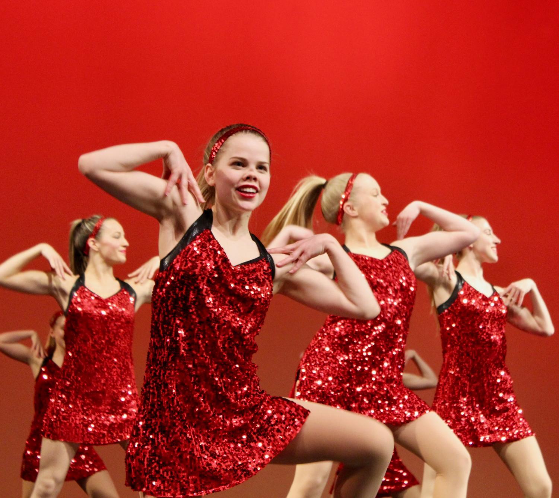 Grace+Hartman%2C+junior%2C+performs+with+the+varsity+Pommies.