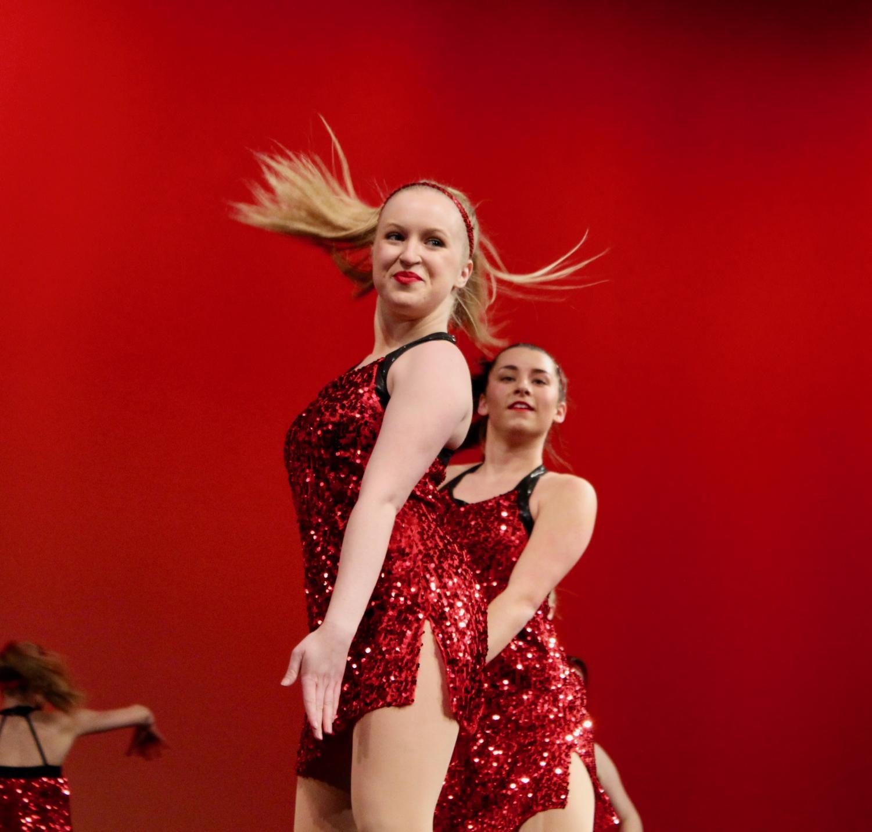 Megan+Villier%2C+senior%2C+looks+into+the+crowd+during+the+varsity+Pommies+dance+routine.